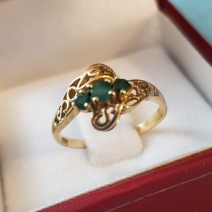 14 K solid gold Emerald ring